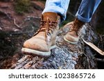 hiking boots close up. girl... | Shutterstock . vector #1023865726