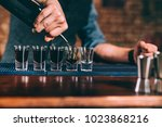 bartender pouring strong... | Shutterstock . vector #1023868216