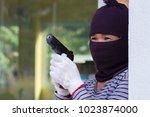 gunman carrying a magazines gun.... | Shutterstock . vector #1023874000