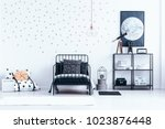 teenager's bed next to a shelf... | Shutterstock . vector #1023876448