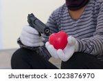 hands of a man holds red heart... | Shutterstock . vector #1023876970