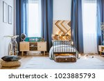 pouf and bike in cozy teenager... | Shutterstock . vector #1023885793