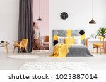 bright  gray and yellow bedroom ... | Shutterstock . vector #1023887014
