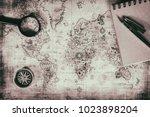 an ancient map  a compass and a ... | Shutterstock . vector #1023898204