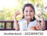 cute asian little child girl... | Shutterstock . vector #1023898720