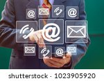 Small photo of Businessman hand press button mail service in network internet.
