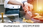 hand of man take cooking of... | Shutterstock . vector #1023919300