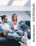 young couple sitting on the... | Shutterstock . vector #1023920668
