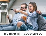 young couple sitting on the... | Shutterstock . vector #1023920680