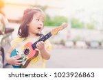 happy little asian girl sing a... | Shutterstock . vector #1023926863