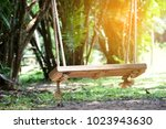 swing hanging with warm light... | Shutterstock . vector #1023943630
