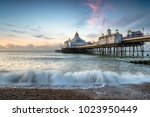 the beach and pier at... | Shutterstock . vector #1023950449