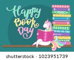 happy book day. unicorn reading ... | Shutterstock .eps vector #1023951739