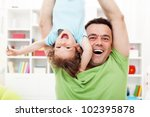 Happy and fun time with father - toddler child and his dad - stock photo