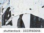 torn posters on grunge old... | Shutterstock . vector #1023960646