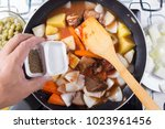 chef putting salt for cooking   ... | Shutterstock . vector #1023961456
