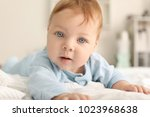 cute little baby lying on bed | Shutterstock . vector #1023968638