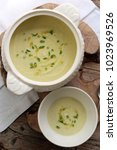 onion cream soup in a bowl. | Shutterstock . vector #1023969526