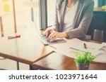 young businesswoman working at... | Shutterstock . vector #1023971644
