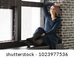 young beautiful girl sits on a... | Shutterstock . vector #1023977536