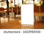 mock up menu frame standing on... | Shutterstock . vector #1023983530