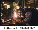 welder in protective uniform... | Shutterstock . vector #1023985099