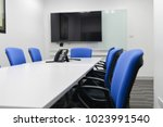 led tv installed to the white... | Shutterstock . vector #1023991540