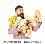 man with happy face hugs teddy... | Shutterstock . vector #1023994078
