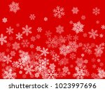 white snowflakes falling on red ... | Shutterstock .eps vector #1023997696