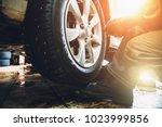 wheel balancing or repair and... | Shutterstock . vector #1023999856