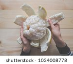 hands peeled pomelo on a... | Shutterstock . vector #1024008778