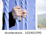 behind bars  person inside... | Shutterstock . vector #102401590