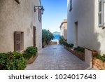 street with white buildings... | Shutterstock . vector #1024017643