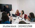 colleagues having a meeting... | Shutterstock . vector #1024021588