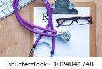 a medical stethoscope near a...   Shutterstock . vector #1024041748