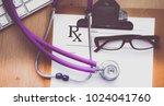 stethoscope on laptop keyboard. ...   Shutterstock . vector #1024041760