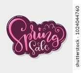 spring sale. a beautiful hand... | Shutterstock .eps vector #1024044760