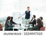 business team gives a... | Shutterstock . vector #1024047310