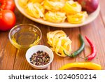 cooking ingredients on a wooden ... | Shutterstock . vector #1024050214