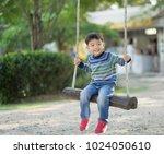 children  little boy playing... | Shutterstock . vector #1024050610