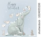 cute winter elephant with hares