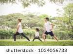 asian family exercising and... | Shutterstock . vector #1024056733