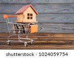 a wooden house on a shopping...   Shutterstock . vector #1024059754