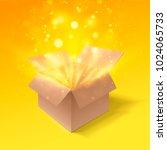 open gift box with bokeh burst...   Shutterstock .eps vector #1024065733