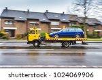 a tow truck transports a... | Shutterstock . vector #1024069906