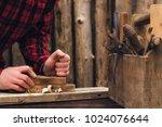 people handles a wooden board | Shutterstock . vector #1024076644