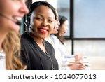 friendly black woman wearing...   Shutterstock . vector #1024077013