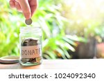 putting coins on donate glass... | Shutterstock . vector #1024092340