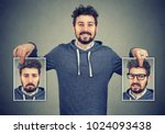 young cheerful hipster holding... | Shutterstock . vector #1024093438