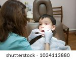 dentist is treating a boy's... | Shutterstock . vector #1024113880